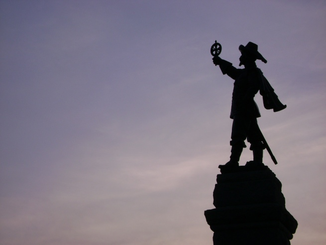 Samuel de Champlain's statue is silhouetted against the twilight sky